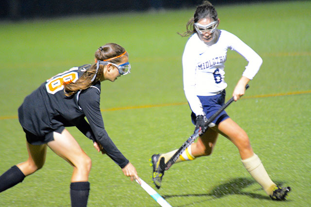 Midlothian's Bella Urcia defends against the Powhatan attack.
