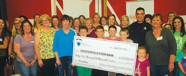 FOOD BANK RECEIVES  BIG CHECK FROM  WOMAN'S CLUB