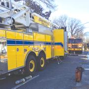 Firefighter injured, seven displaced