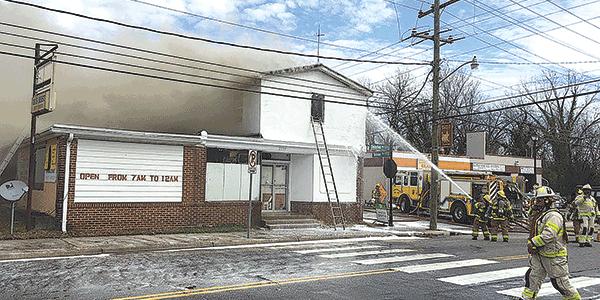 Ettrick store burns, firefighter injured