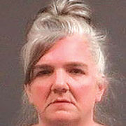 Woman charged with arson