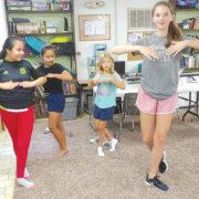 Volunteers teach children at trailer park