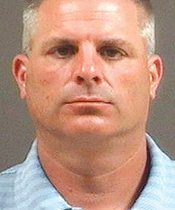 Former Bird AD, coach charged with embezzlement