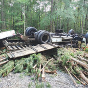 Driver issued five summonses after dump truck crash