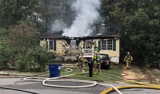 Firefighter injured, two displaced by house fire