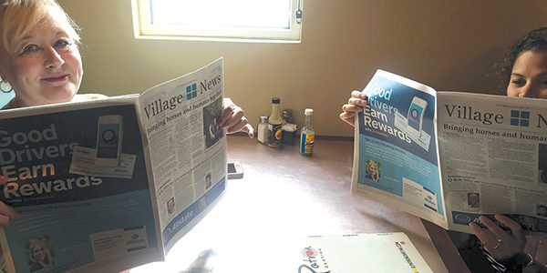 Caught reading the Village News
